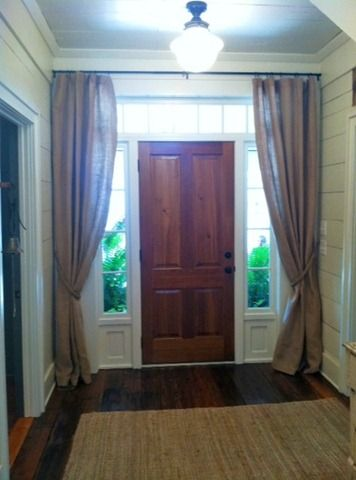 Great for cozying up an entry! This would solve the problem of window coverings for our front windows, too...