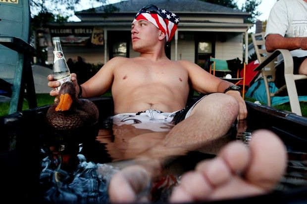 Jay Herzog cools off in a tub outside of a rental house on Junction Avenue during the Sturgis motorcycle rally on Thursday evening, August 6, 2010. (Kristina Barker/Journal staff)