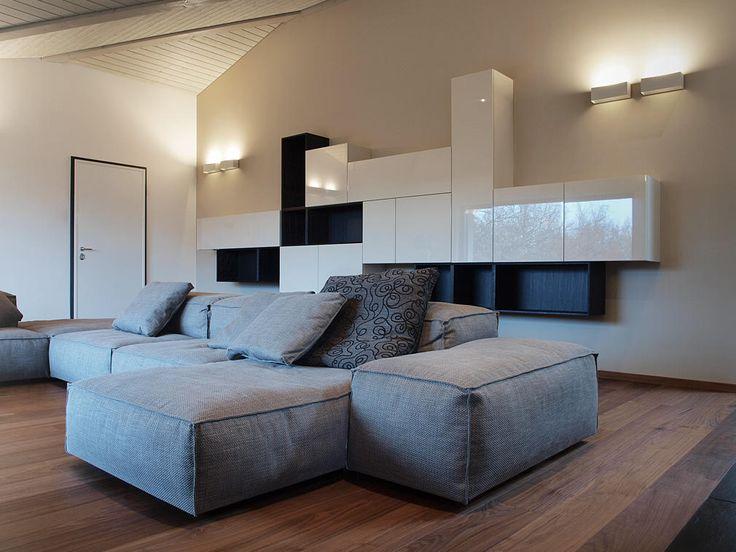 Progetto di arredamento completo a Lugano. Cucina varenna Matrix, soggiorno Porro e Living Divani, armadi Porro e arredobagno su misura Plus.