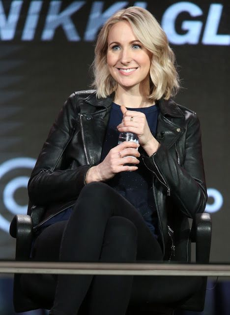 Celebrities In Leather: Nikki Glaser wears a black leather jacket.