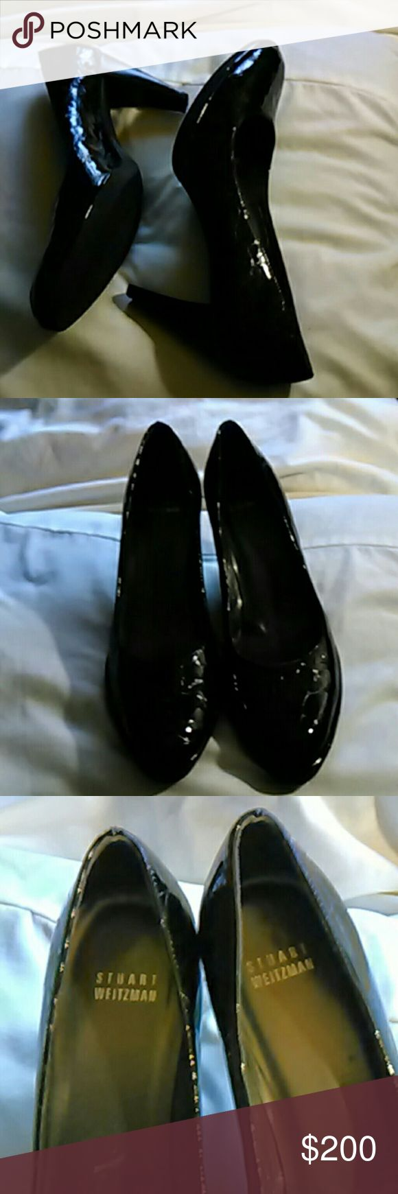 Stuart Weitzman  heels size 8.5 gorgeous patent leather shoes. With wood grain heel and Rubber Sole bottoms these shoes are in excellent condition. These shoes cost $455. They are a size eight and a half medium. No scuffs no scratches in excellent condition Stuart Weitzman Shoes Heels