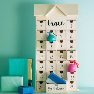 Personalised Wooden Christmas House Advent Calendar. Pick a delightfully different advent calendar this Christmas to celebrate the coolest countdown of the year.
