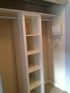 Ikea hack Closet Makeover. Would be great for our hall closet - move shelves to one side, include bins for gloves, hats, dog leashes, etc.