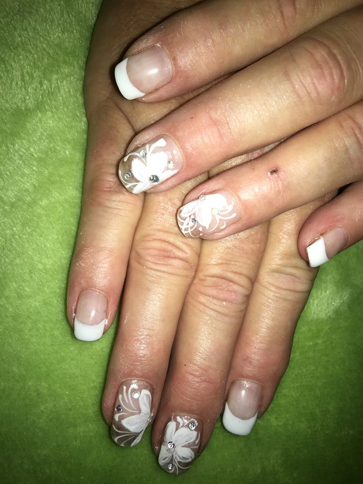 White french with white flower art, a beautiful wedding set of gel nails