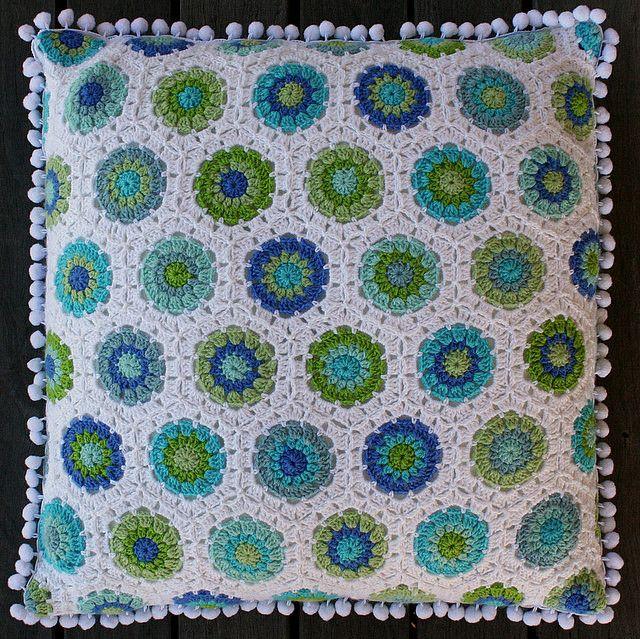 Gorgeous crocheted blanket with pom pom trim