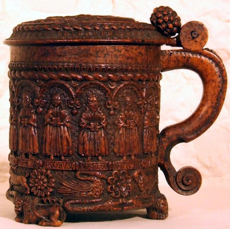 The Glastonbury Grace Cup, a 16th century oak tankard intricately carved with images of the 12 Apostles, the crucifixion of Christ, birds, beasts and flowers. Beautiful.: