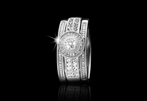 Be the talk of the town with this sterling silver, diamond and created white sapphire wedding set.