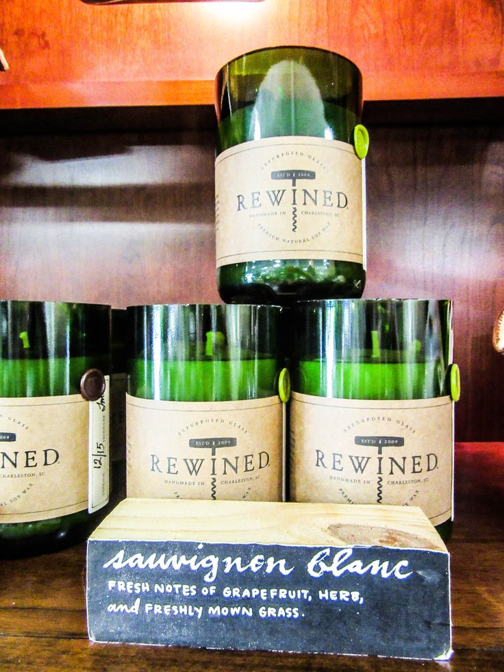 rewined candles contained in recycled wine bottles available here at blu ivory home decor - Home Decor Houston
