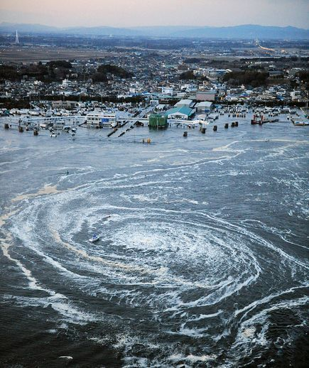 Japan tsunami and earthquake picture: whirlpool caused by a tsunami in Japan  news.nationalgeographic.com