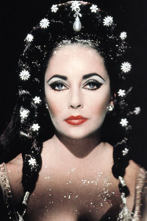 """Actress Elizabeth Taylor in """"Dr. Faustus"""" by photographer Nevill Coghill (1966)."""