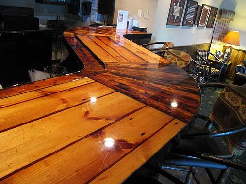 natural wooden countertops reclaimed wood shaped into a curved countertop for a hotel bar. Black Bedroom Furniture Sets. Home Design Ideas
