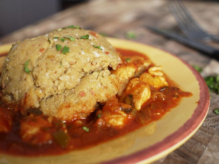 Garlicy Chicken Mofongo in a divine red sauce. 5 star recipe that's out of this world.
