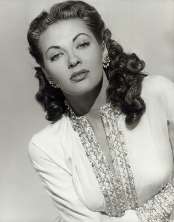 "Yvonne De Carlo (1922–2007) was a Canadian actress, singer, & dancer whose career in film, television, & theater spanned six decades. Described as ""the most beautiful girl in the world"", she obtained her breakthrough role in Salome, Where She Danced (1945). Her film career reached its peak when director Cecil B. DeMille cast her as Sephora, the wife of Moses, her most prominent role, in his biblical epic The Ten Commandments (1956). She played Lily Munster in the CBS sitcom The Munsters"