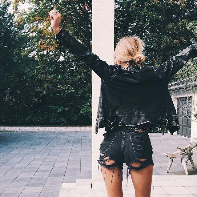 leather jacket and shredded denim shorts