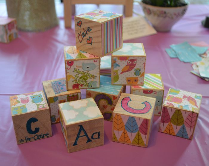 I love these!! Create your own wooden blocks at the baby shower. There is also a wooden letter as the guest book that is awesome too!