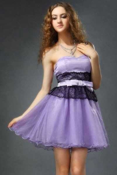 Violet Mesh & Lace Bridesmaid Dress NZD$59.99      A gentle, romantic pale violet evening dress featuring two layers of organza mesh over a satin layer, with black lace and ribbon decoration at the waist.      Padded sweetheart bust   Elastic back for a perfect fit   Made of 4 layers: poly underlayer, satin layer and two organza layers   Opens with hidden side zipper   Includes optional detachable spaghetti straps      Materials: organza, lace, satin         Size and Measurements   Size 14…
