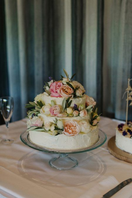 simple homemade wedding cake decorated with fresh roses