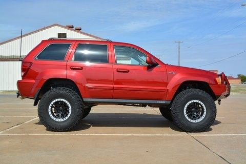 "Lifted jeep grand Cherokee WK. 37"" tires"