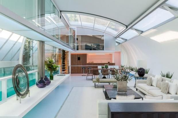 £10m Primrose Hill penthouse for sale: hidden in a row of mews houses, this hi-tech home comes with a retractable roof, neon-lit pool and rooftop terrace