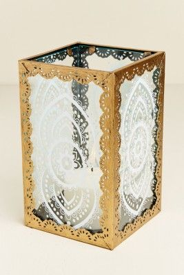 This small hurricane lantern is perfect for an outdoor patio or even indoors! Skillfully made using soda glass (glass made using soda or soda ash), this lantern features white mandala designs and an iron trim with ornamental cutouts. Use it to hold your favorite tealight candle, or try filling it with crystals, or even Himalayan pink sea salt! It also looks great paired with our large white mandala hurricane lantern! Use only with a tealight candle on a temperature-safe surface.