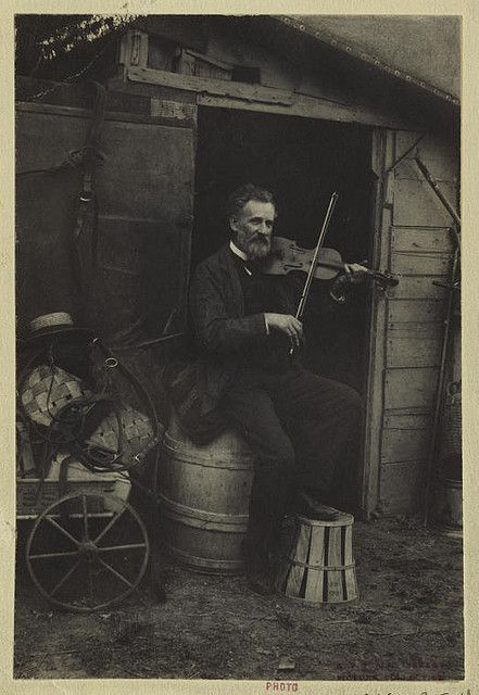 Violin player, 1898-1905. The New York Public Library. Mid-Manhattan Library. Picture Collection.