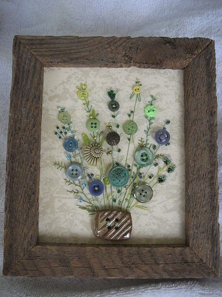 I have handsewn each button and hand embroidered the stems on fabric. Seed beads are sewn to the tops of the stems as flower buds. This sweet decorative picture is framed in a rustic barnwood frame 6 x 7 with a sawtooth hanger on the back. This is a one of a kind piece.
