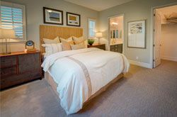 Beautifully decorated master bedroom and suite, in the Larkin plan. Stop by and tour this elegant model home today at East Garrison in Monterey County!
