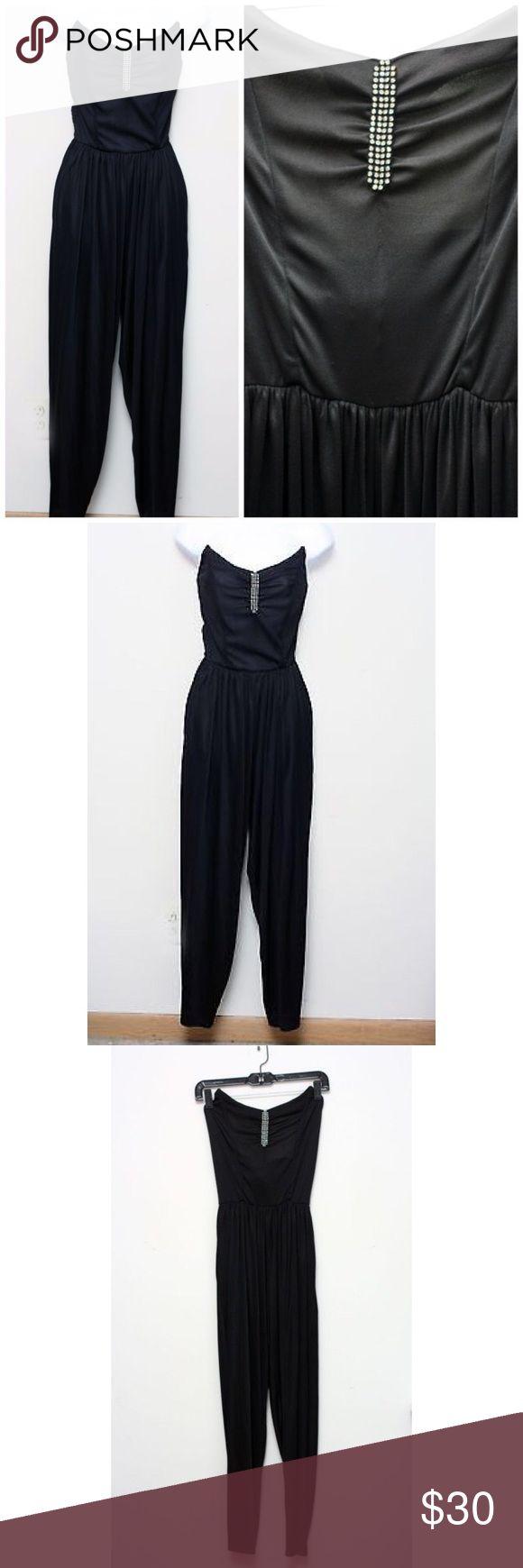 "Vtg 80s Black Stretch Strapless Bandeau Jumpsuit Vtg 80s Black Stretch Strapless Bandeau Jumpsuit. Sweetheart plunge neckline with rhinestone embellishments.  Measurements (flat / un-stretched):  Tagged Size: 8 Bust: 31"" Inseam: 28"" Vintage Pants Jumpsuits & Rompers"