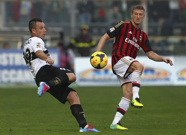 Antonio Cassano of Parma FC competes for the ball with Ignazio Abate of AC Milan during the Serie A match between Parma FC and AC Milan at S...