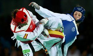 Team GB's Jade Jones kicks out at Eva Calvo Gomez of Spain during their Olympic…