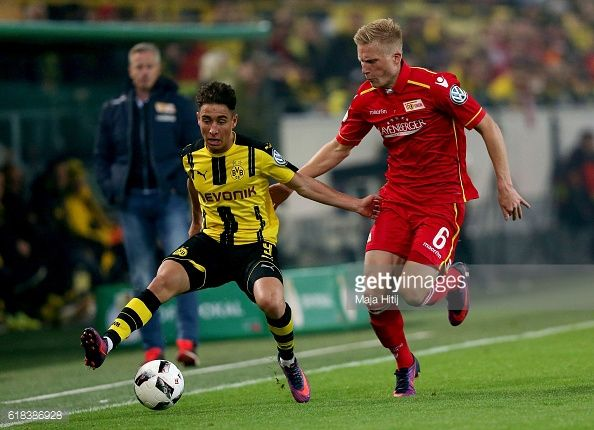 Emre Mor of Dortmund and Kristian Pedersen of Berlin battle for the ball during DFB Cup second round match between Borussia Dortmund and 1 FC Union...