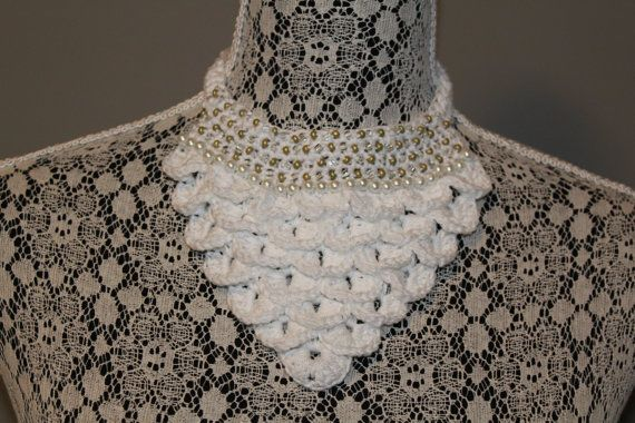 Hand made crocodile stitch crochet bib necklace with pearl & gold tone small bead accents. Fastens at the back with a button. This necklace is