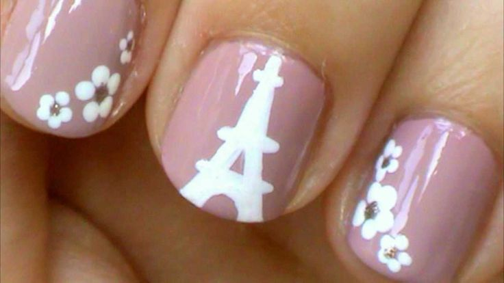 Eiffel Tower Nails! Here is an Eiffel Tower nail design with flowers. I hope you like this tutorial. I painted the Eiffel Tower with white acrylic paint, but...