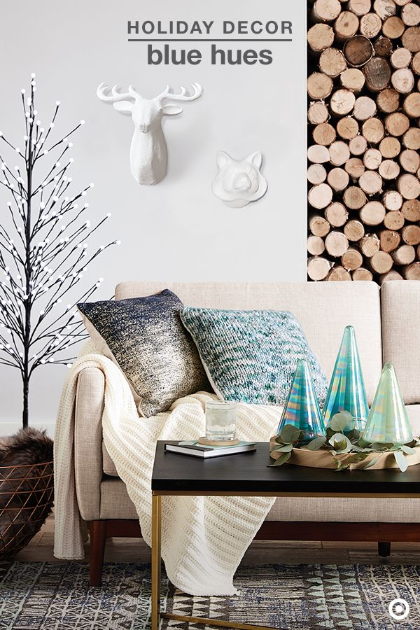 Create a luxurious and welcoming space this holiday season by mixing in cool blues, a little shimmer and loads of comfort. Luminous teal mercury glass trees, sparkly snowflake wall decor and a pre-lit twig tree add the perfect amount of sparkle and shine, providing an exquisite holiday ambiance. And, having soft, faux-fur or knit blankets, and toss pillows nearby will easily up the cozy factor on a chilly winter night.