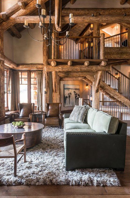 pearson design group love the log accents - Cabin Interior Design Photos