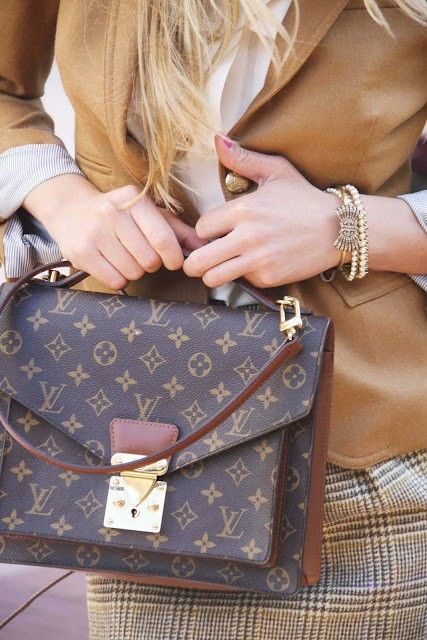 Every woman loves a great Louis Vuitton bag and a fitted suit. Must haves in any closet of course!