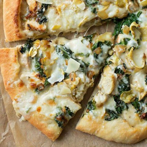 You know the spinach and artichoke dip that you get at your favorite bar? Now, put it on a pizza. The best of both worlds!