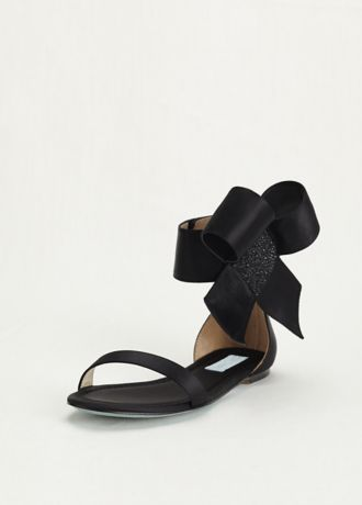 Make a bold fashion statement in these chic ankle bow sandals! Blue by Betsey Johnson flat satin sandals feature an elegant oversized bow at the ankle, complete with crystal embellishments for some extra sparkle. Available in Black and Ivory. Available in sizes 6-10. Imported.