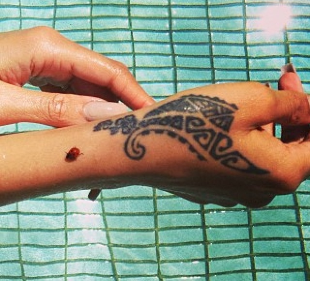 Rihanna's Tattoo: It's tribal. It represents strength and love