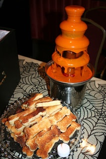 Tomato soup served in Chocolate fountain with bone shaped grilled cheese sandwiches - favorite halloween party element!