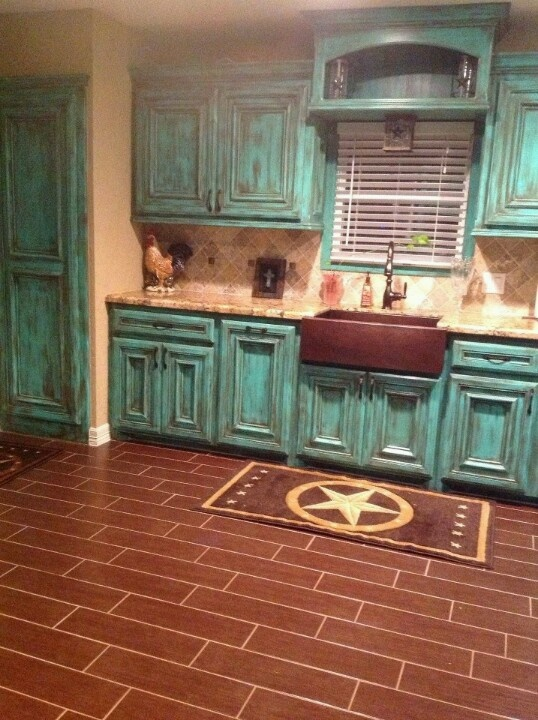 Love the turquoise cabinets! Love shelf above the window and that sink