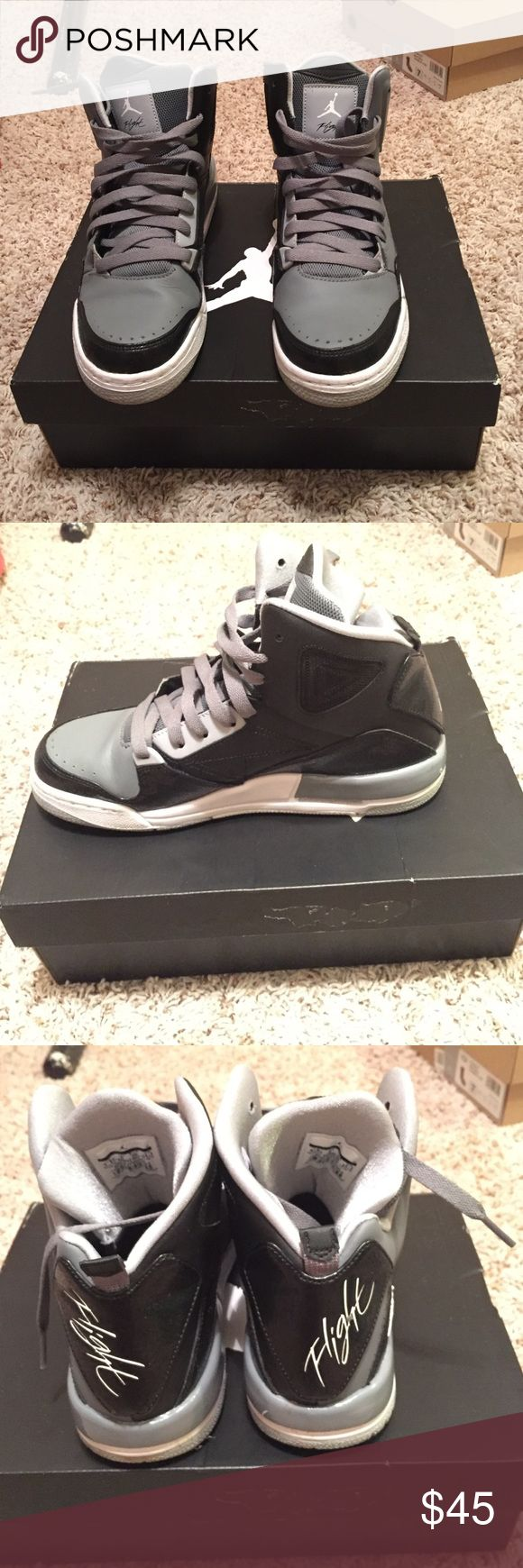 Like new Jordan's high top tennis shoes These shoes have only been worn once to prom! They are gray and black and are in great condition. Size 6.5Y. I wear size 7.5 in women's and they fit! Make an offer in the comments! Jordan Shoes Sneakers