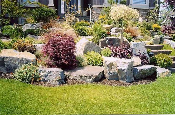 Pictures of landscaped lawns home decorating ideas for - Landscaping with large rocks ...