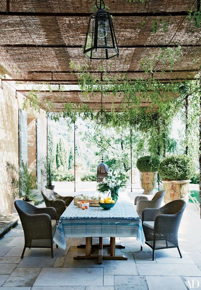 Balinese-teak tables from Designers Views anchor a terrace off the main house at the Aix-en-Provence retreat of French beauty guru Frédéric Fekkai and his wife, Shirin von Wulffen. The seating, also teak, was crafted locally.