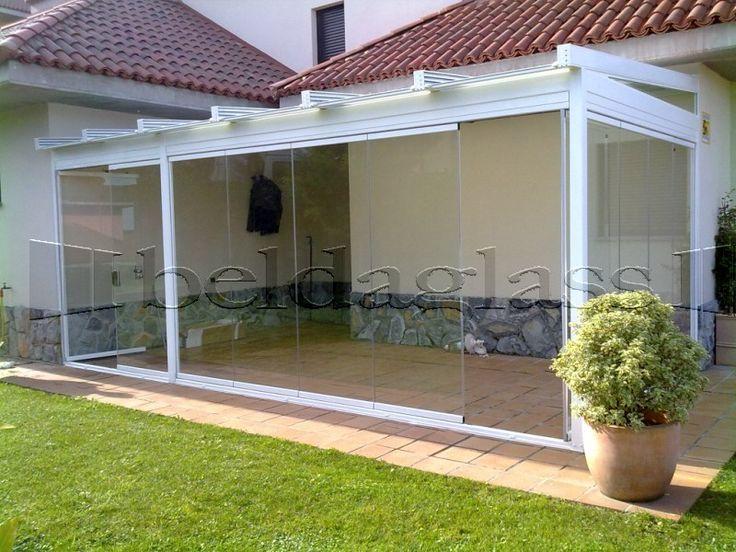 cerramiento de terraza compuesto por techo de cristal y cerramiento panoramico ó cortina de cristal