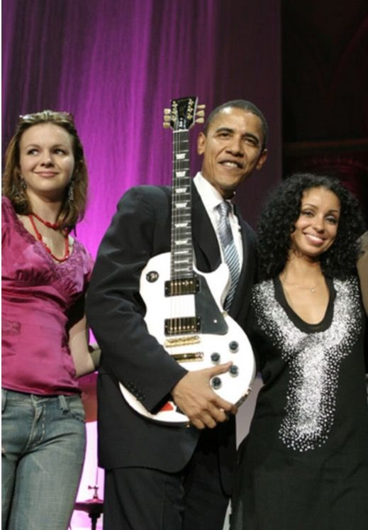 Barack Obama (Then Senator) poses with Amber Tamblyn and Mya at the 12th Annual Rock the Vote Awards held at the National Building Museum on June 8, 2005 in Washington, DC.