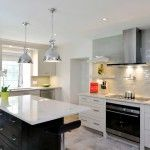 kitchen island with cooktop in Kitchen Transitional with cooktop beige tile backsplash
