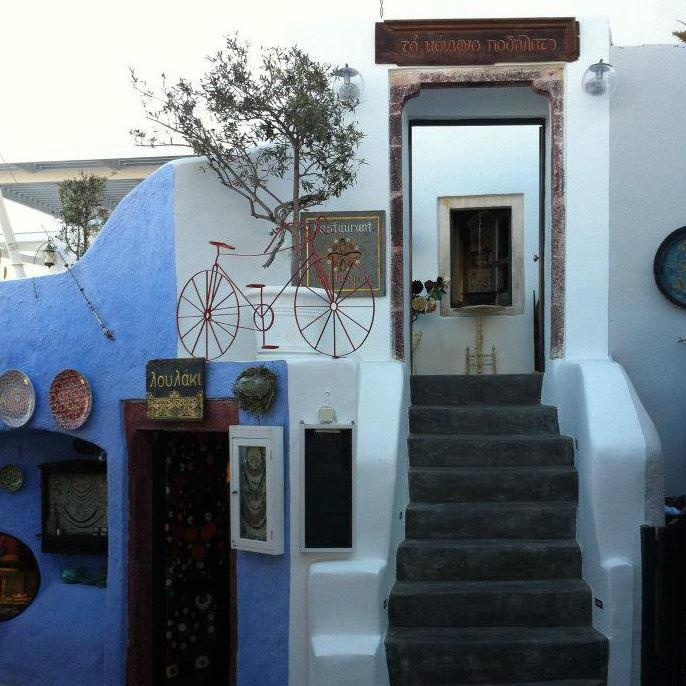 """""""Red Bicycle"""" restaurant in Oia, Santorini"""