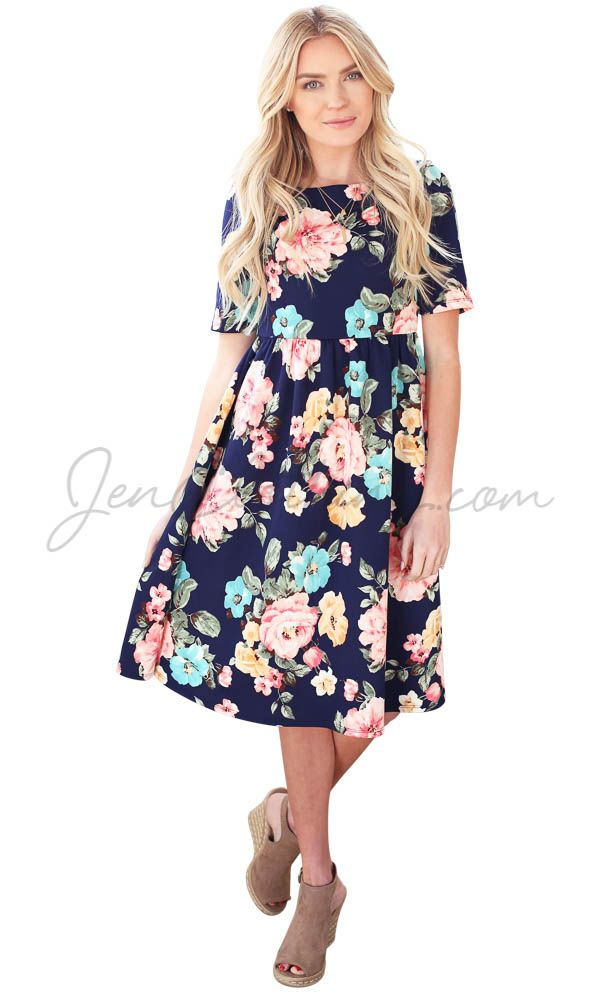 We dare you to find a prettier floral print dress this season! Perfectly styled, perfectly cool & comfortable, and the perfect blend of bright colors against the dark navy background!   Natalie Modest Dress in Navy Blue w/Multicolored Floral Print