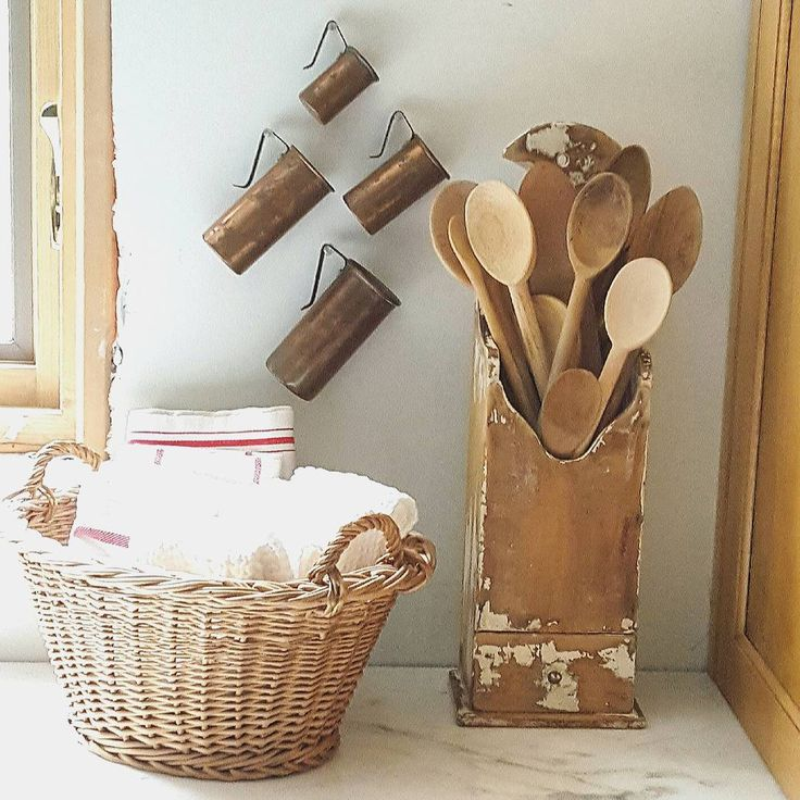 Simple rustic farmhouse kitchen Wooden spoons, vintage linens, French copper measuring cup. Photo by SerendipityRefined on Instagram